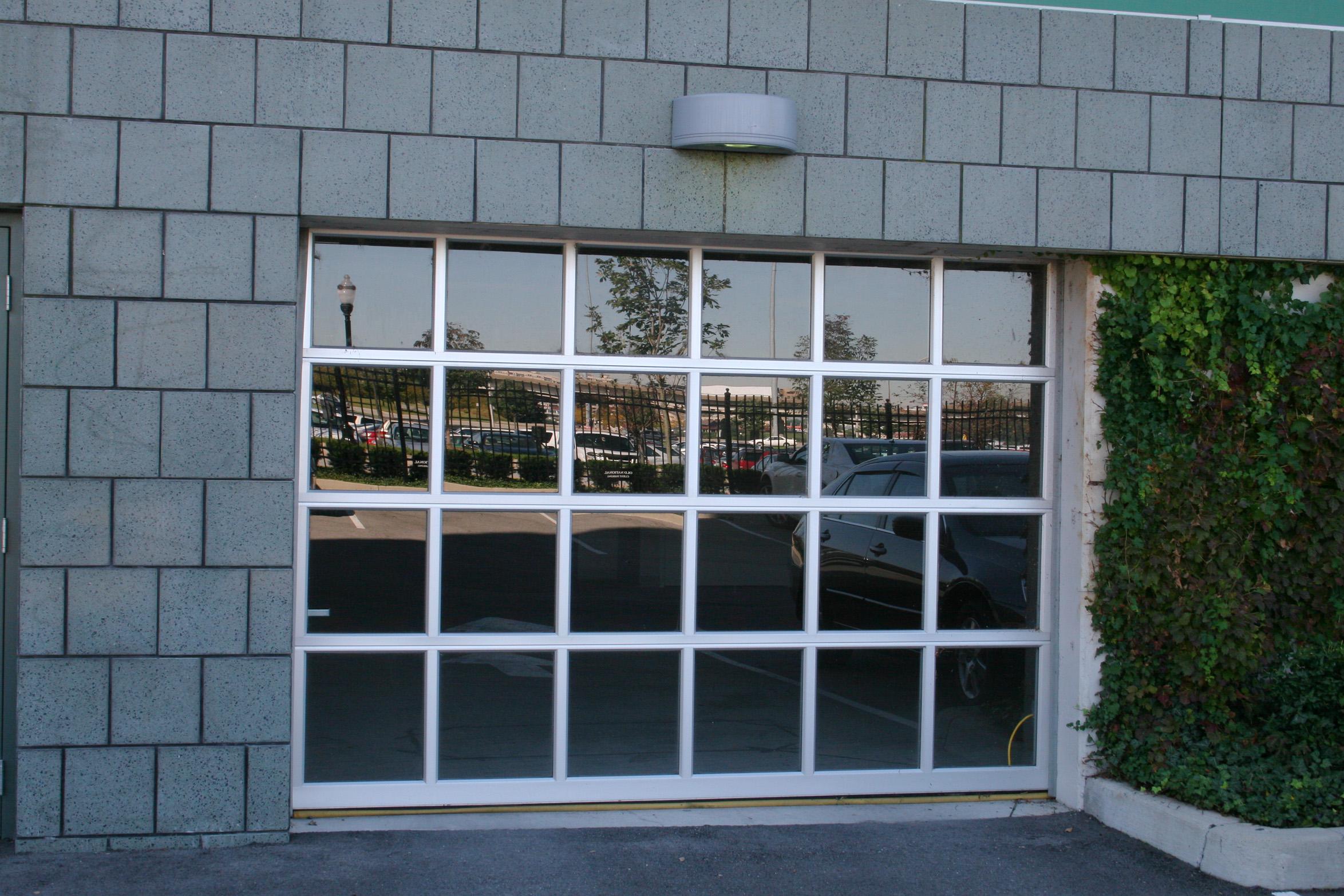 Clopay commercial doors cunningham door window for Clopay hurricane garage doors