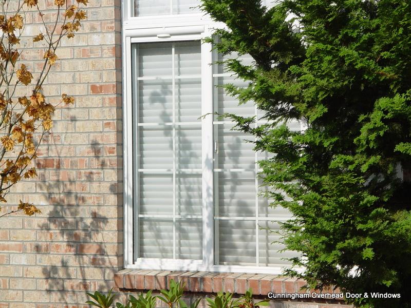 Reel screens cunningham door window for Vertical retractable screen